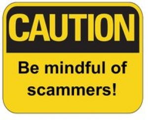 Be mindful of scammers sign